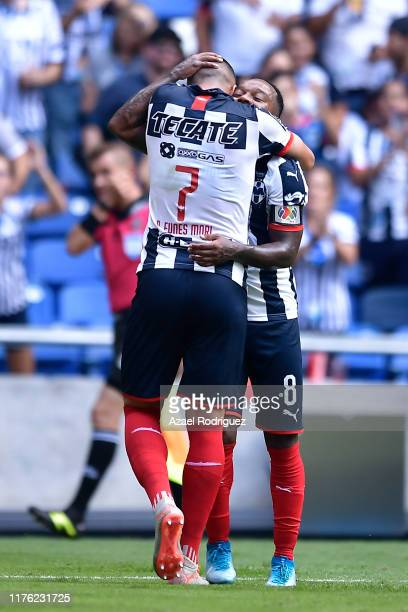 Rogelio Funes Mori #7 of Monterrey celebrates with teammate Dorlan Pabon #8 after scoring his team's second goal during the 10th round match between...