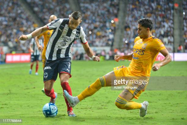 Rogelio Funes Mori, #7 of Monterrey, fights for the ball with Carlos Salcedo, #3 of Tigres, during the 12th round match between Monterrey and Tigres...