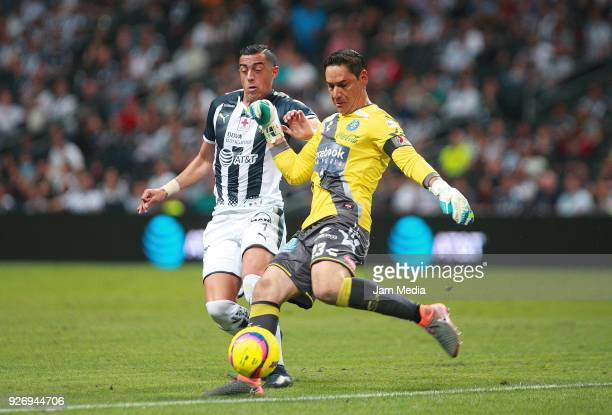 Rogelio Funes Mori of Monterrey and Moises Munoz of Puebla fight for the ball during the 10th round match between Monterrey and Puebla as part of the...