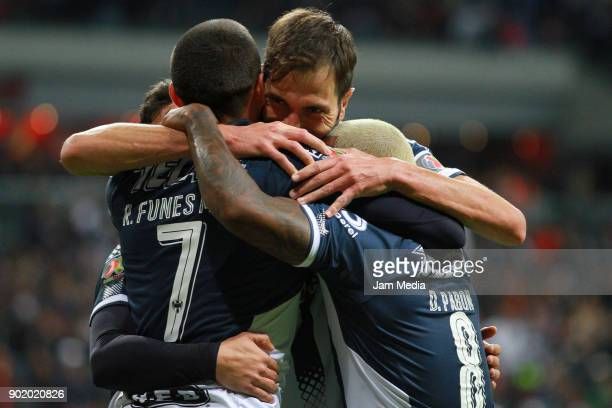 Rogelio Funes Mori of Monterrey celebrates his goal with his teammates during the first round match between Monterrey and Morelia as part of the...