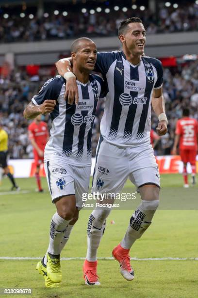 Rogelio Funes Mori of Monterrey celebrates with teammate Carlos Sanchez after scoring his team's third goal during the 6th round match between...