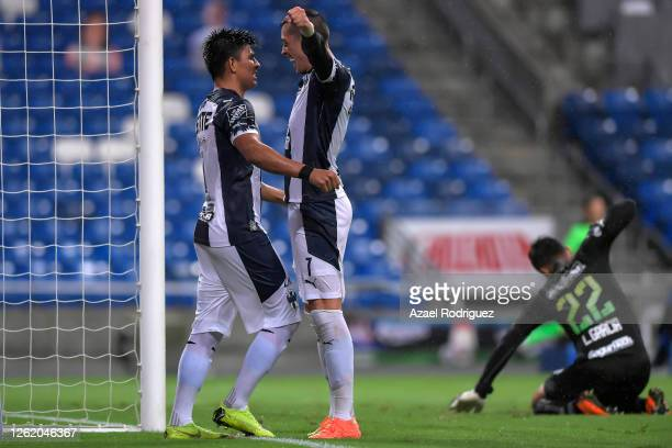 Rogelio Funes Mori of Monterrey celebrates with teammate Jesús Gallardo of Monterrey after scoring his team's third goal over Luis García of Toluca...