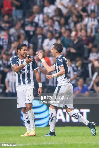 Rogelio Funes Mori of Monterrey celebrates with teammate Jorge Benitez after scoring his team's fourth goal during the semifinal second leg match...