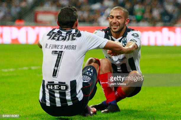 Rogelio Funes Mori of Monterrey celebrates with teammate Walter Gargano after scoring the third goal of his team during the match between Monterrey...