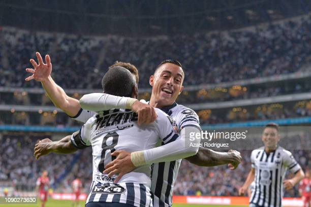 Rogelio Funes Mori of Monterrey celebrates with teammates after scoring his team's third goal during the first round match between Monterrey and...
