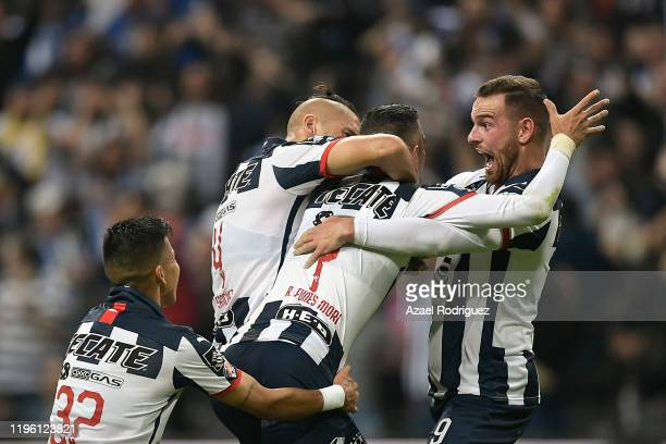 Rogelio Funes Mori of Monterrey celebrates with teammates after scoring his team's second goal during the Final first leg match between Monterrey and...