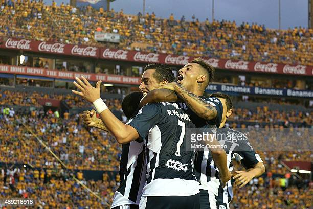 Rogelio Funes Mori of Monterrey celebrates with teammates after scoring his team's first goal during a 9th round match between Tigres UANL and...