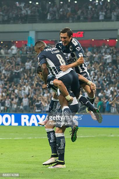 Rogelio Funes Mori of Monterrey celebrates with teammates after scoring his team's second goal during the semi finals second leg match between...