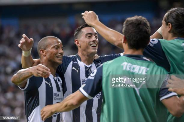 Rogelio Funes Mori of Monterrey celebrates with teammates after scoring his team's third goal during the 6th round match between Monterrey and Toluca...