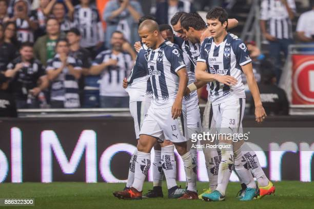 Rogelio Funes Mori of Monterrey celebrates with teammates after scoring his team's fourth goal during the semifinal second leg match between...