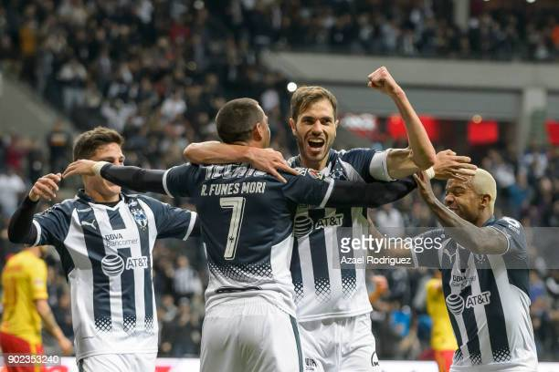 Rogelio Funes Mori of Monterrey celebrates with teammates after scoring his team'u2019s first goal during the first round match between Monterrey and...