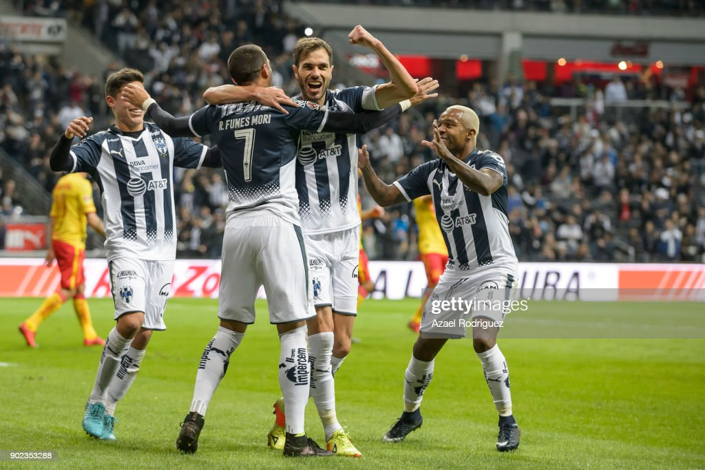 Rogelio Funes Mori of Monterrey celebrates with teammates after scoring his team'u2019s first goal during the first round match between Monterrey and Morelia as part of the Torneo Clausura 2018 Liga MX at BBVA Bancomer Stadium on January 6, 2018 in Monterrey, Mexico.