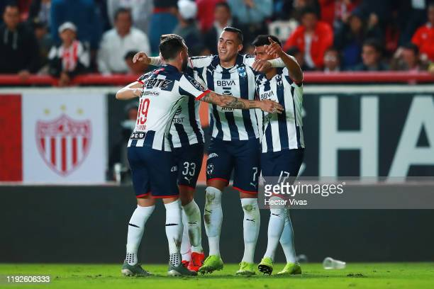 Rogelio Funes Mori of Monterrey celebrates with teammates after scoring the first goal of his team during the Semifinals second leg match between...