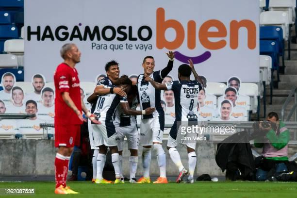 Rogelio Funes Mori of Monterrey celebrates with teammates after scoring the first goal of his team during the 1st round match between Monterrey and...