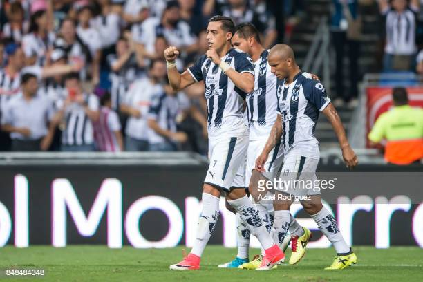 Rogelio Funes Mori of Monterrey celebrates with teammates after scoring the winning goal during the 9th round match between Monterrey and Atlas as...
