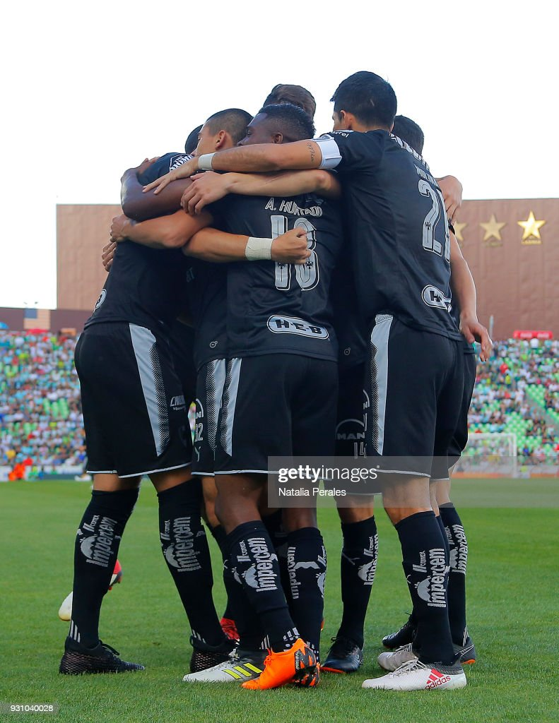Rogelio Funes Mori of Monterrey celebrates with teammates after scoring the first goal of his team during the 11th round match between Santos Laguna and Monterrey as part of the Torneo Clausura 2018 Liga MX at Corona Stadium on March 11, 2018 in Torreon, Mexico.