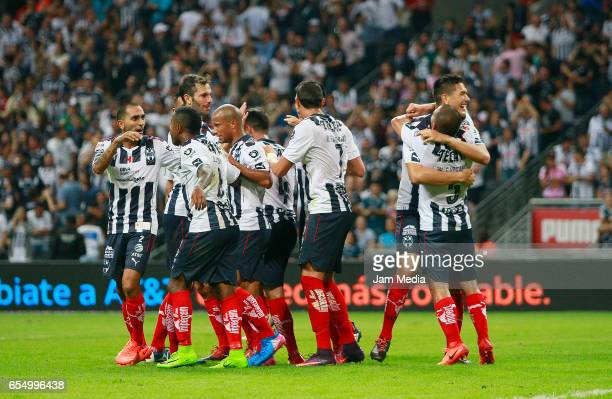 Rogelio Funes Mori of Monterrey celebrates with teammates during the 11th round match match between Monterrey and Atlas as part of the Torneo...