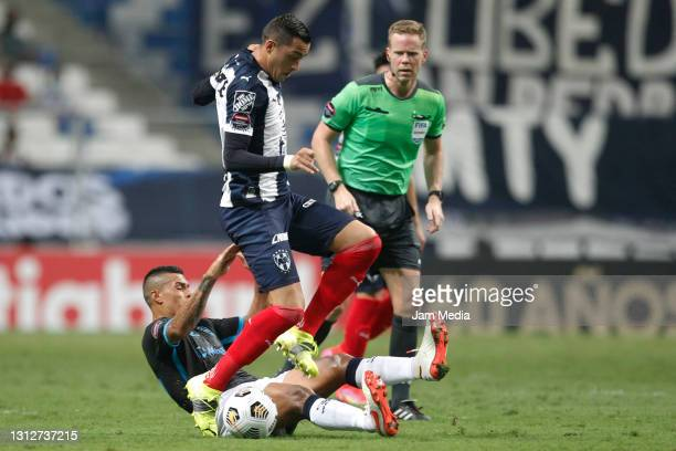 Rogelio Funes Mori of Monterrey fights for the ball with Alexis Ossa of Atletico Pantoja during a second leg match between Monterrey and Atletico...