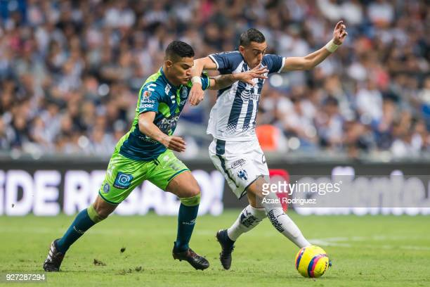 Rogelio Funes Mori of Monterrey fights for the ball with Anderson Santamaria of Puebla during the 10th round match between Monterrey and Puebla as...