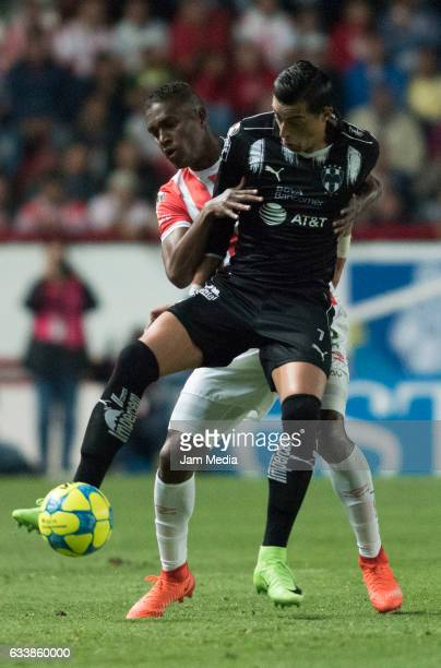 Rogelio Funes Mori of Monterrey fights for the ball with Brayan Beckeles of Necaxa during the 5th round match between Necaxa and Monterrey as part of...