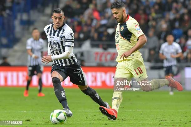 Rogelio Funes Mori of Monterrey fights for the ball with Bruno Valdez of América during the 4th round match between Monterrey and America as part of...
