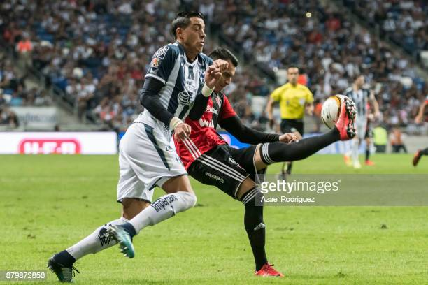 Rogelio Funes Mori of Monterrey fights for the ball with Daniel Arreola of Atlas during the quarter finals second leg match between Tigres UANL and...
