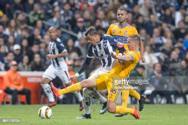 Rogelio Funes Mori of Monterrey fights for the ball with Jesus Dueñas of Tigres during the second leg of the Torneo Apertura 2017 Liga MX final...
