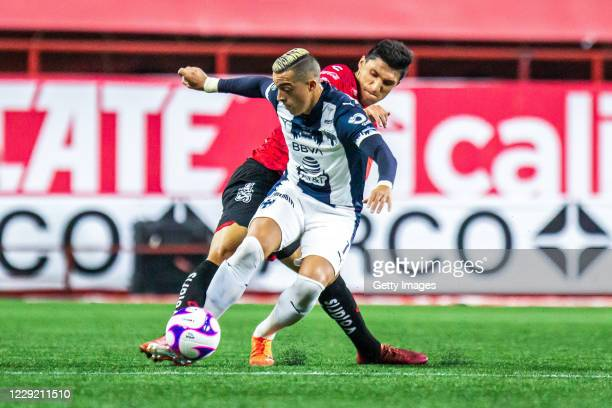 Rogelio Funes Mori of Monterrey fights for the ball with Jordan Silva of Tijuana during the Final first leg match between Tijuana and Monterrey as...