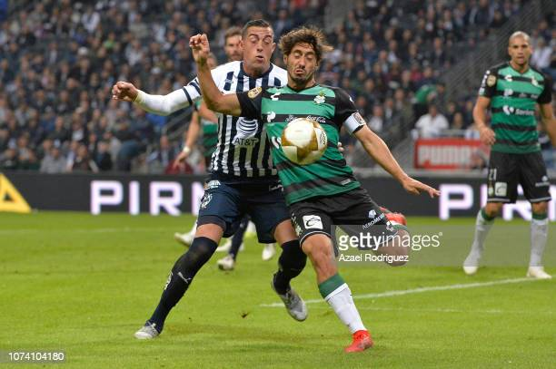 Rogelio Funes Mori of Monterrey fights for the ball with José Abella of Santos during the quarter finals first leg match between Monterrey and Santos...