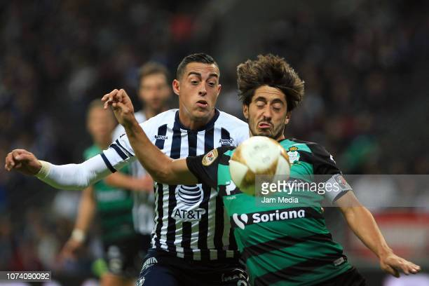 Rogelio Funes Mori of Monterrey fights for the ball with Jose Abella of Santos during the quarter finals first leg match between Monterrey and Santos...