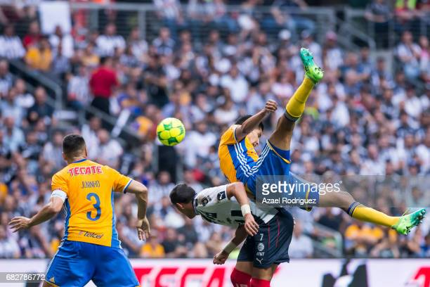 Rogelio Funes Mori of Monterrey fights for the ball with Juninho and Hugo Ayala of Tigres during the quarter finals second leg match between...