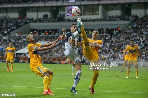 Rogelio Funes Mori of Monterrey fights for the ball with Juninho and Rafael De Souza of Tigres during the 17th round match between Monterrey and...