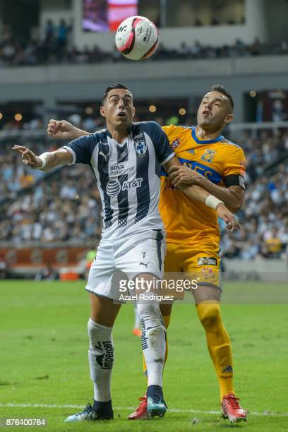 Rogelio Funes Mori of Monterrey fights for the ball with Juninho of Tigres during the 17th round match between Monterrey and Tigres UANL as part of...