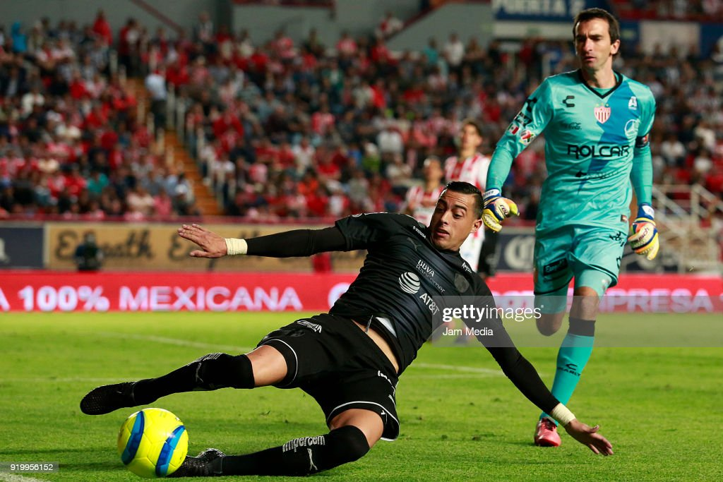 Rogelio Funes Mori (L) of Monterrey fights for the ball with Marcelo Barovero (R) goalkeeper of Necaxa during the 8th round match between Necaxa and Monterrey as part of the Torneo Clausura 2018 Liga MX at Victoria Stadium on February 17, 2018 in Aguascalientes, Mexico.