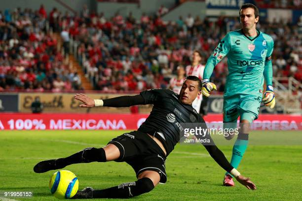 Rogelio Funes Mori of Monterrey fights for the ball with Marcelo Barovero goalkeeper of Necaxa during the 8th round match between Necaxa and...
