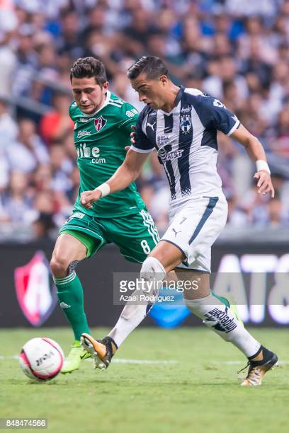 Rogelio Funes Mori of Monterrey fights for the ball with Uvaldo Luna of Atlas during the 9th round match between Monterrey and Atlas as part of the...