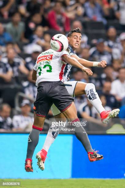 Rogelio Funes Mori of Monterrey heads the ball with Mario De Luna of Necaxa during the 8th round match between Monterrey and Necaxa as part of the...