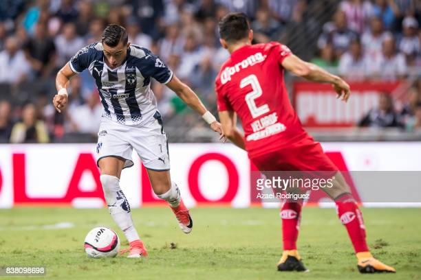Rogelio Funes Mori of Monterrey shoots to score his team's third goal during the 6th round match between Monterrey and Toluca as part of the Torneo...