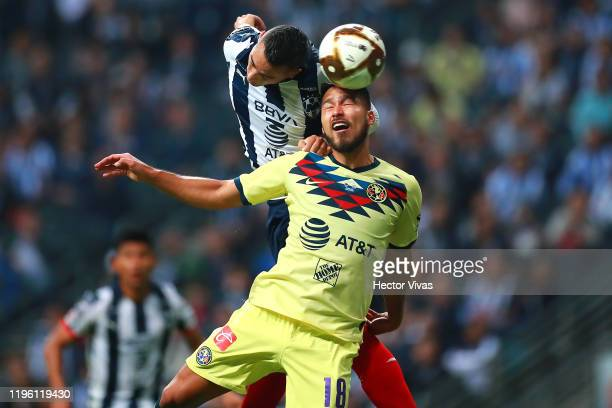 Rogelio Funes Mori of Monterrey struggles for the ball against Bruno Valdez of America during the Final first leg match between Monterrey and America...