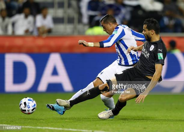 Rogelio Funes of CF Monterrey shoots while challenged by Boualem Khoukhi of AlSadd Sports Club during the FIFA Club World Cup 2nd round match between...