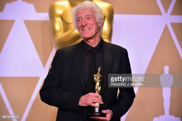 """Roger A. Deakins poses in the press room with the Oscar for Best Cinematography for """"Blade Runner 2049,"""" during the 90th Annual Academy Awards on..."""