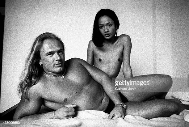 Roger a German sex tourist with a 19 year old katoey prostitute in his hotel room in Pattaya The katoey has not yet had a sex change because the cost...