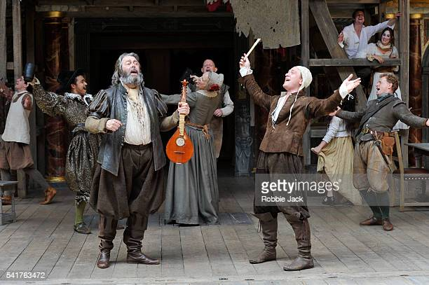 Roger Allam as Falstaff and Jamie Parker as Hal with artists of the company in the production of William Shakespeare's Henry IV Parts 1 and 2...