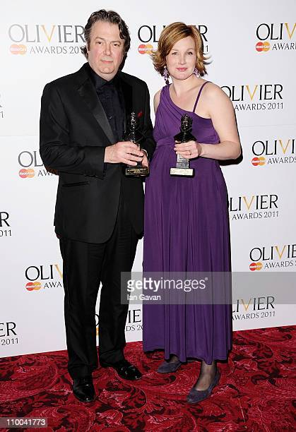 Roger Allam winner of Best Actor for Henry IV and Nancy Carroll winner of Best Actress for After the Dance pose in the press room during The Olivier...