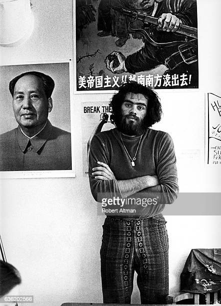 Roger Alvarado poses for a portrait as he stands next to a picture of China's Chairman Mao Mao Zedong as Roger is part of Los Venceramos a Communist...