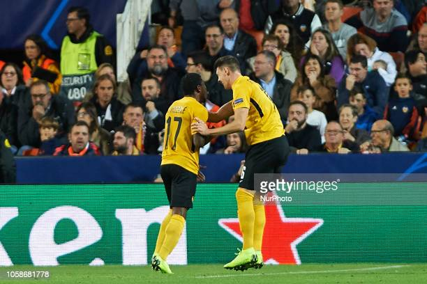 Roger Assale and Sandro Lauper of Young Boys celebrates a goal during the UEFA Champions League group H match between Valencia FC and Young Boys at...