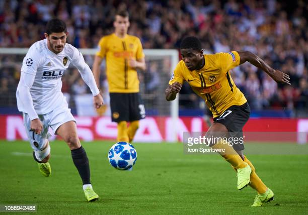 Roger Assale forward of BSC Young Boys competes for the ball with Gonçalo Guedes midfielder of Valencia CF during the UEFA Champions League group...