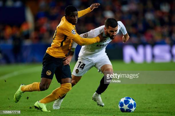Roger Assale of BSC Young Boys competes for the ball with Jose Gaya of Valencia CF during the Group H match of the UEFA Champions League between...