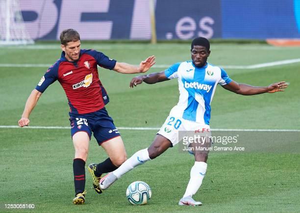 Roger Assale of Leganes battles for possession with Darko Brasanac of Osasuna during the Liga match between CA Osasuna and CD Leganes at Estadio El...