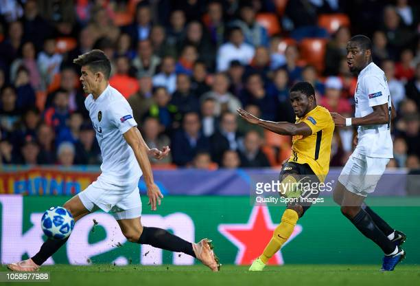 Roger Assale of Young Boys shoots to goal surrounded by players of Valencia during the Group H match of the UEFA Champions League between Valencia...